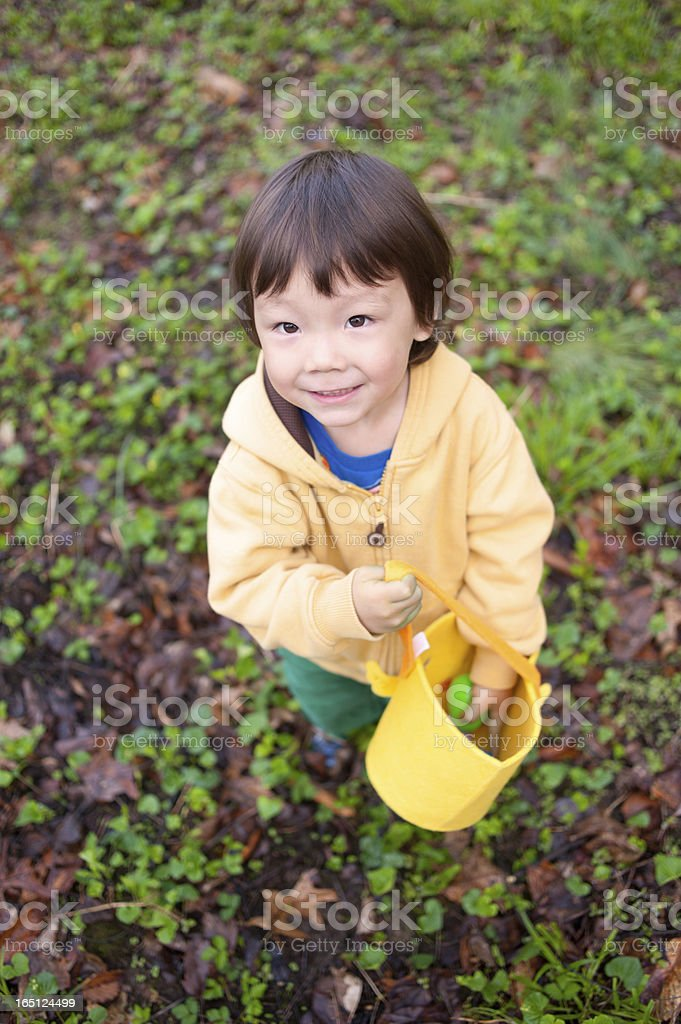 Young Korean American Boy Hunting Easter Eggs royalty-free stock photo