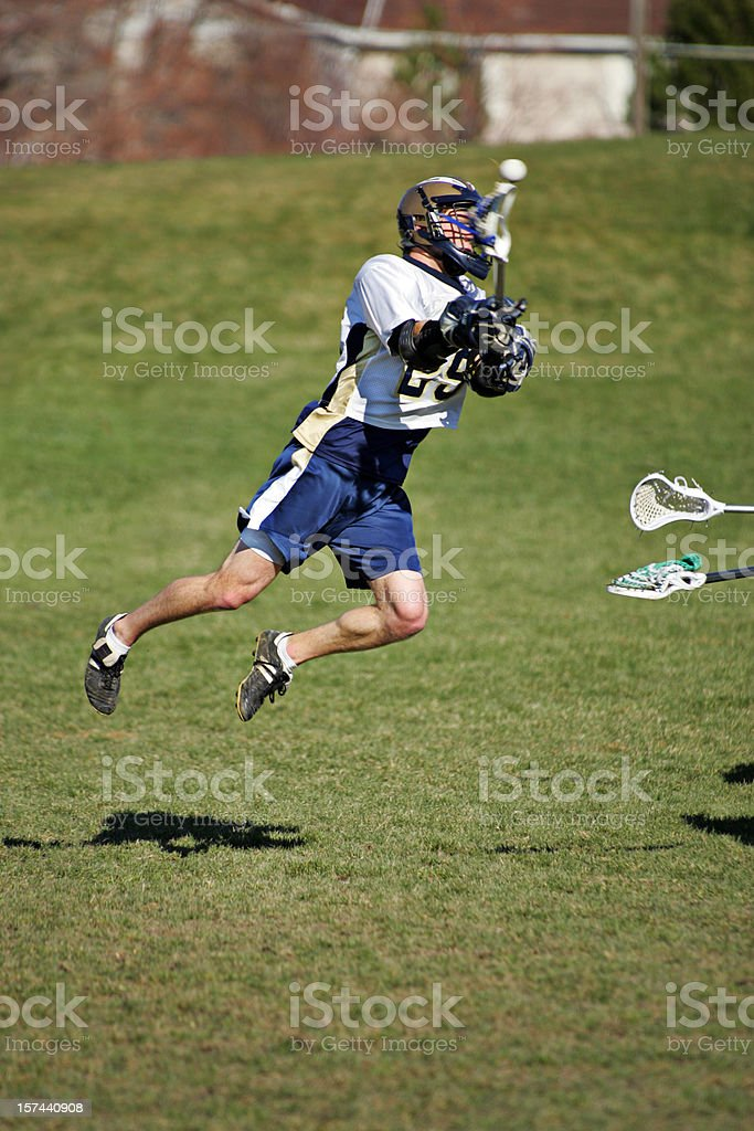 Young Lacrosse Player Jumps and Shoots with copy space stock photo