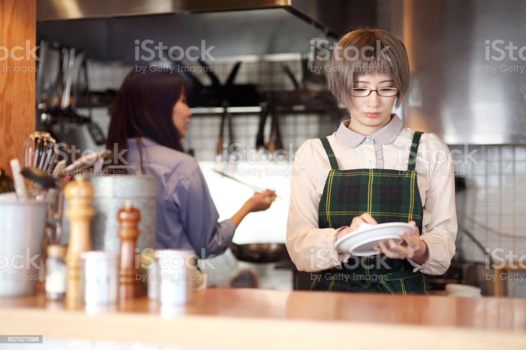 Young ladies in the kitchen. stock photo
