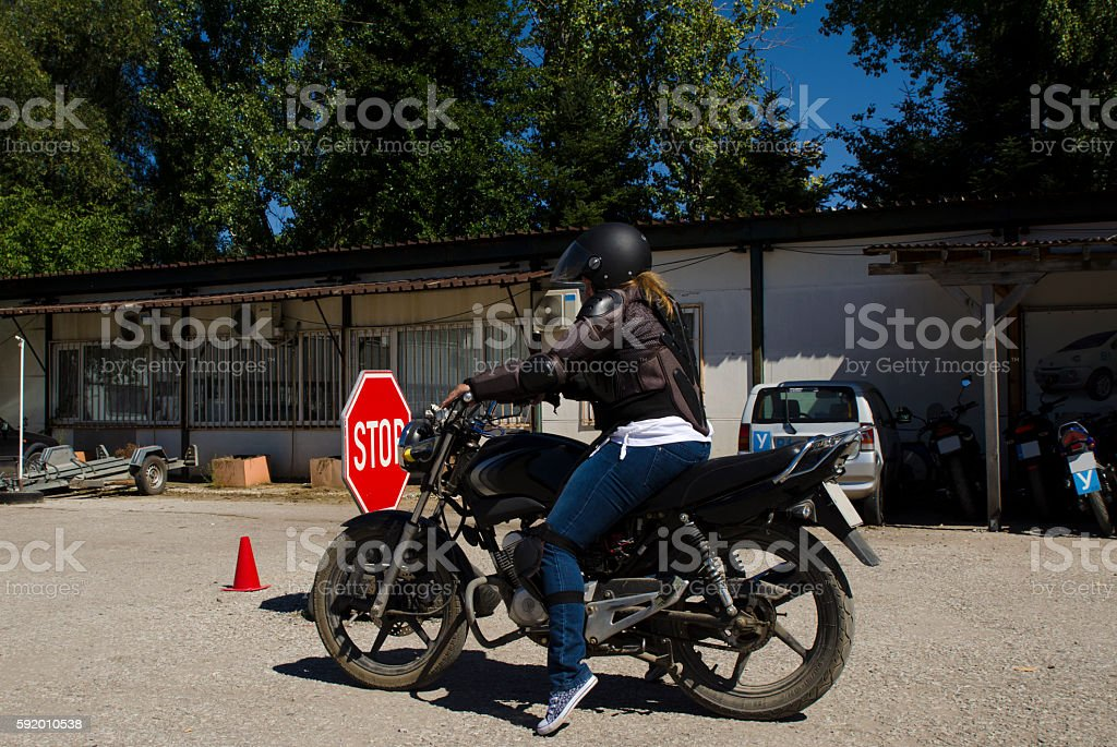 Young lady at a mororcycle training course stock photo