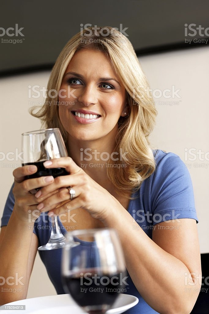 Young lady at restaurant having a glass of wine royalty-free stock photo
