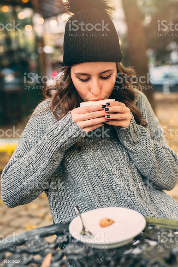 Young lady at the cafe stock photo