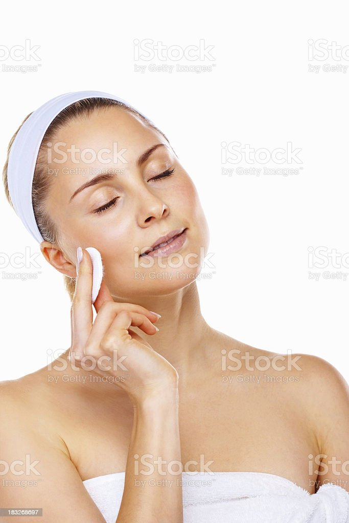 Young lady cleaning her face with cotton swab royalty-free stock photo