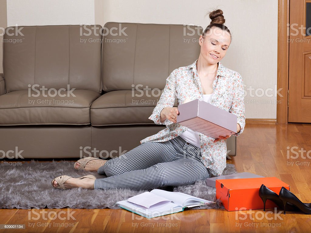 Young lady does some shopping online. stock photo