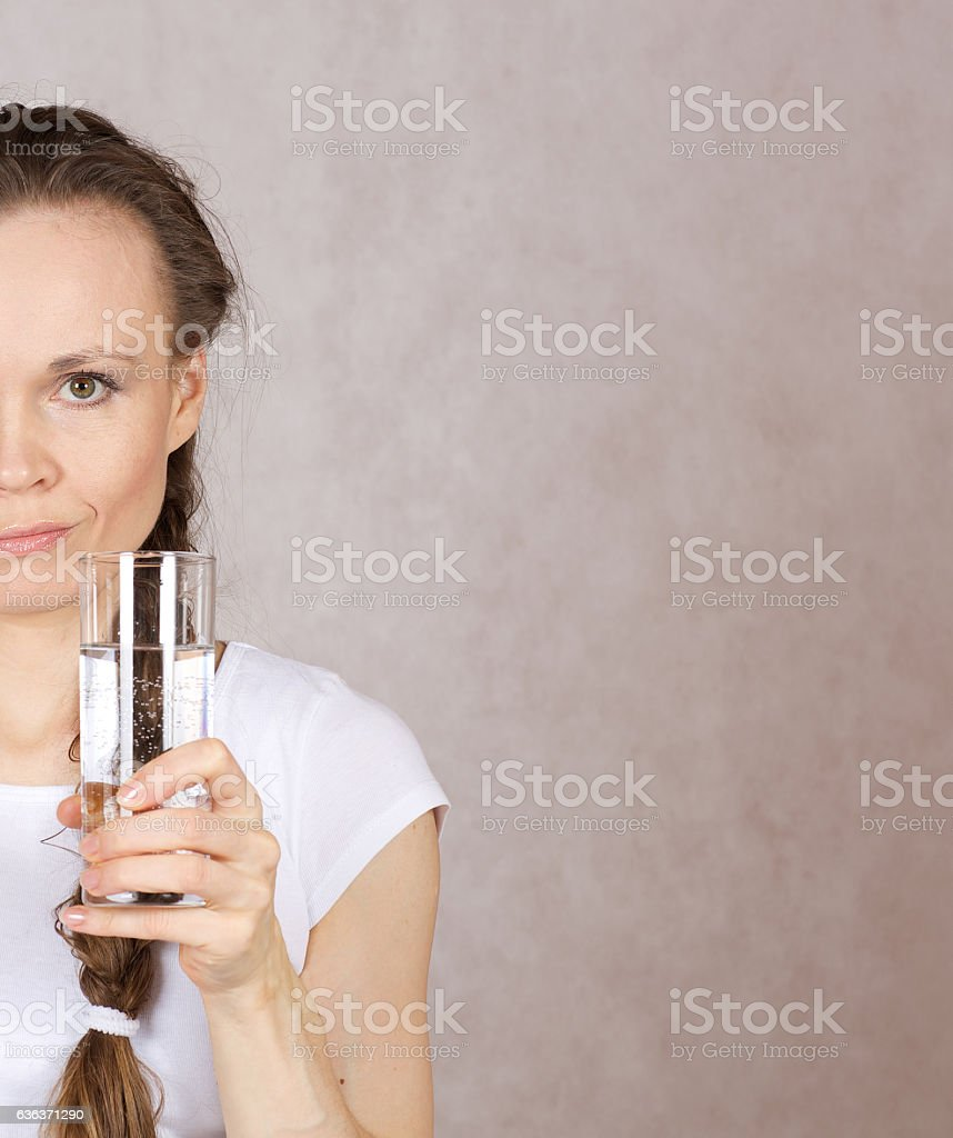 Young lady has a glass of water stock photo