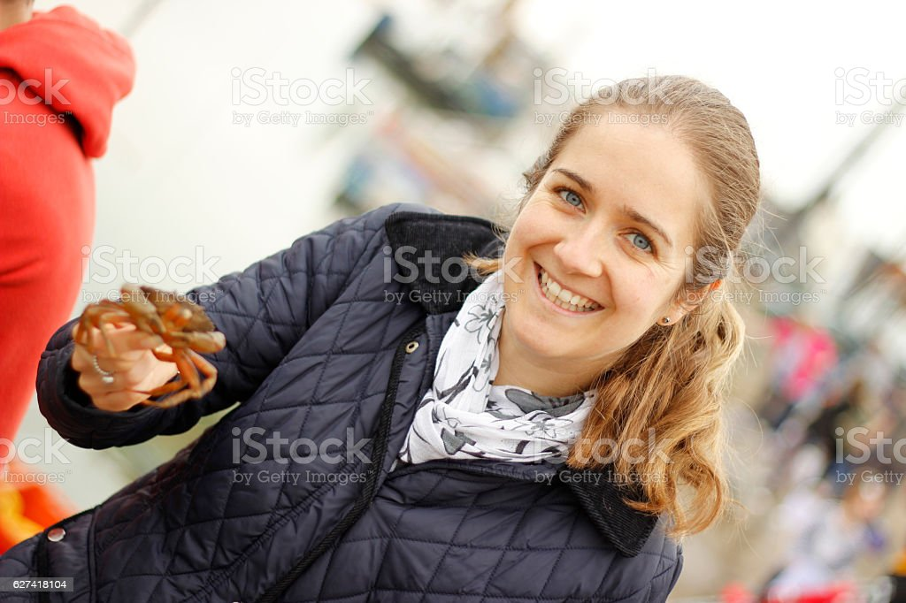 Young Lady holding a Crab stock photo