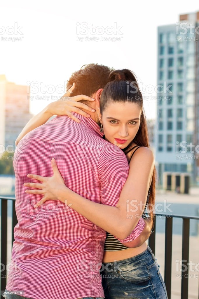 Young lady hugging man. stock photo