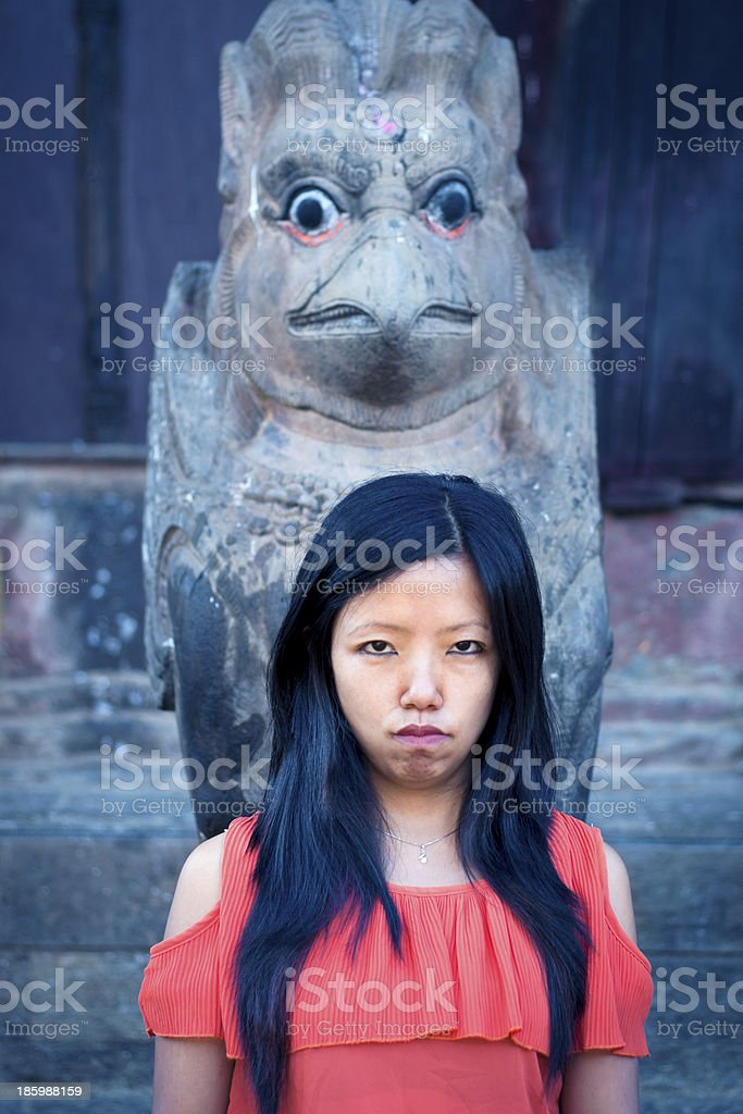 Young Lady in Front of Sculpture royalty-free stock photo