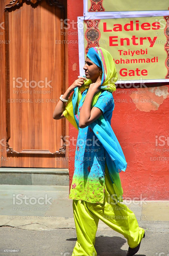 Young lady in vibrant traditional dress stock photo