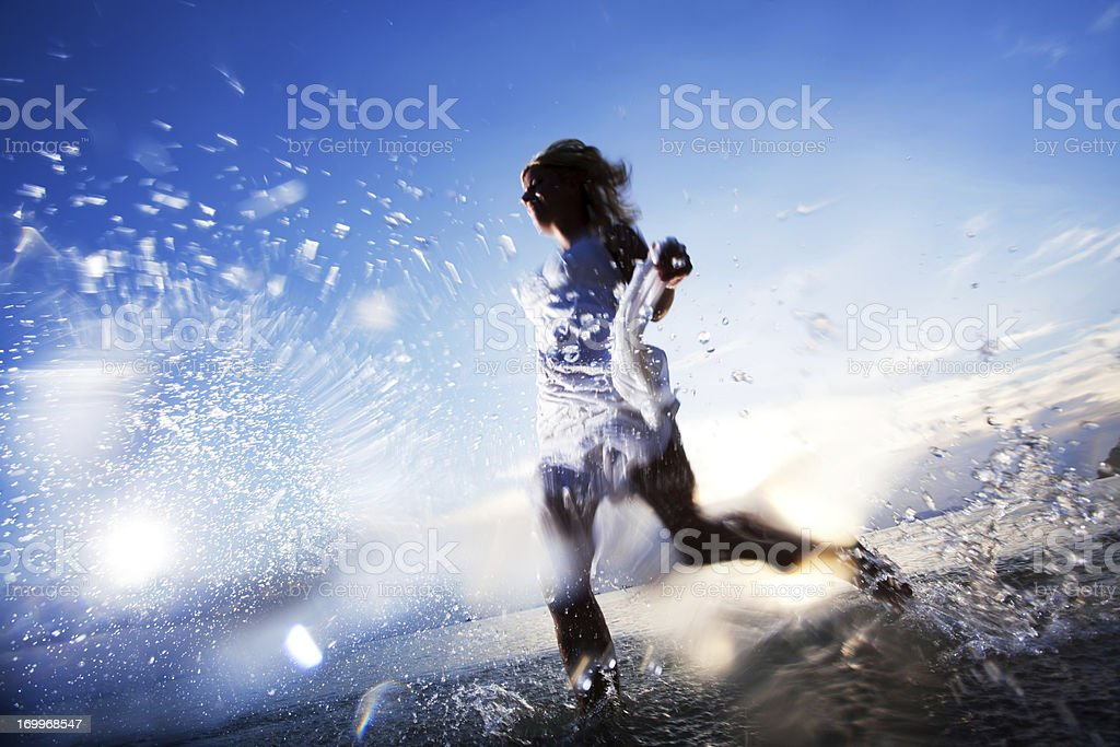 Young lady jogging in the water. royalty-free stock photo