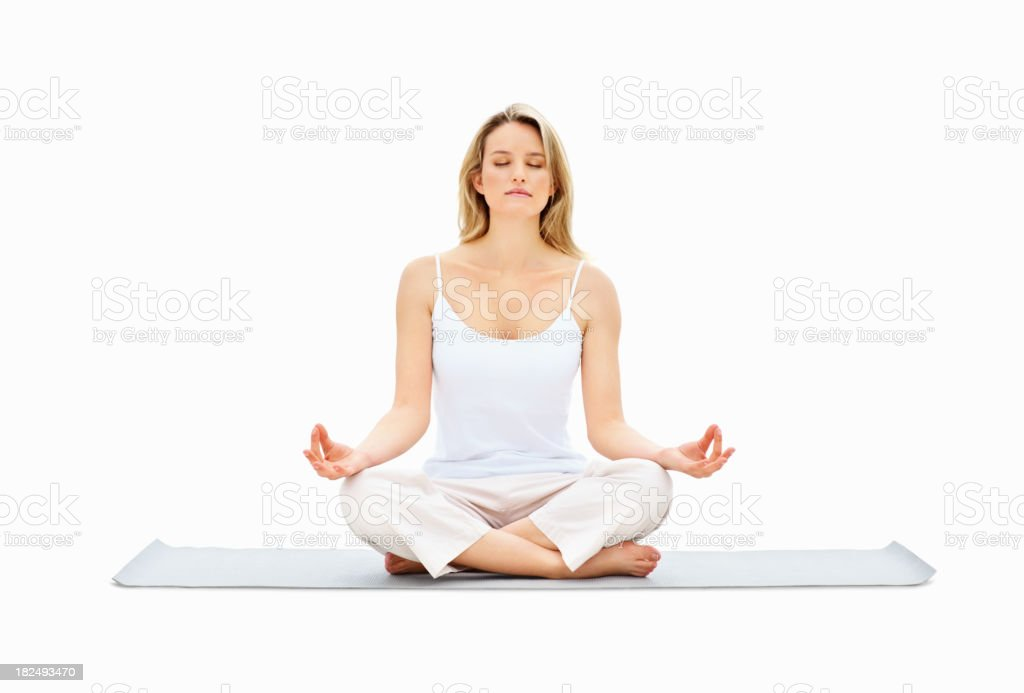 Young lady meditating in lotus position over white royalty-free stock photo