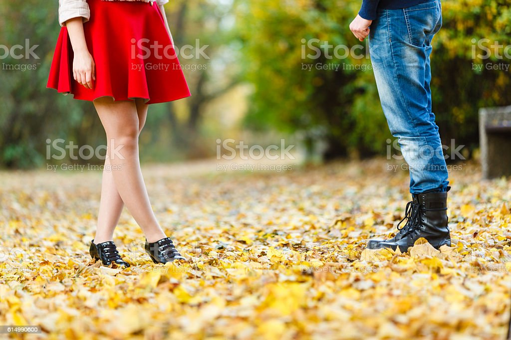 Young lady meeting rough boy. stock photo