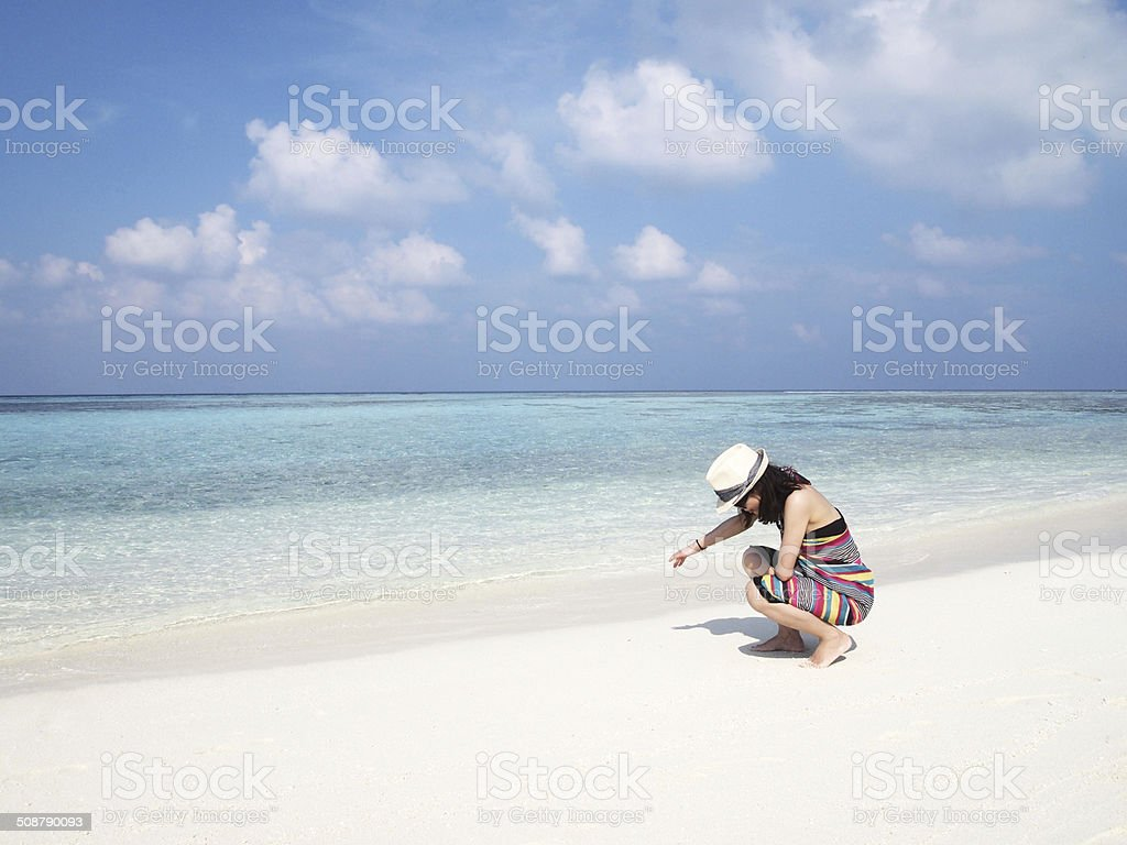 Young lady on the beach of Maldives Island stock photo