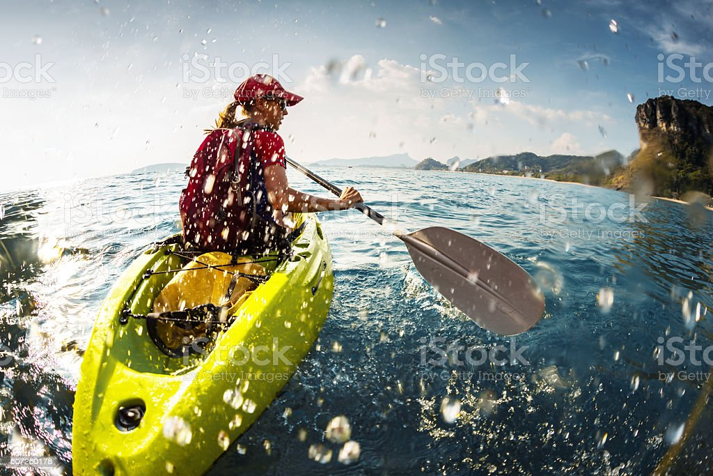 Young lady paddling the kayak stock photo