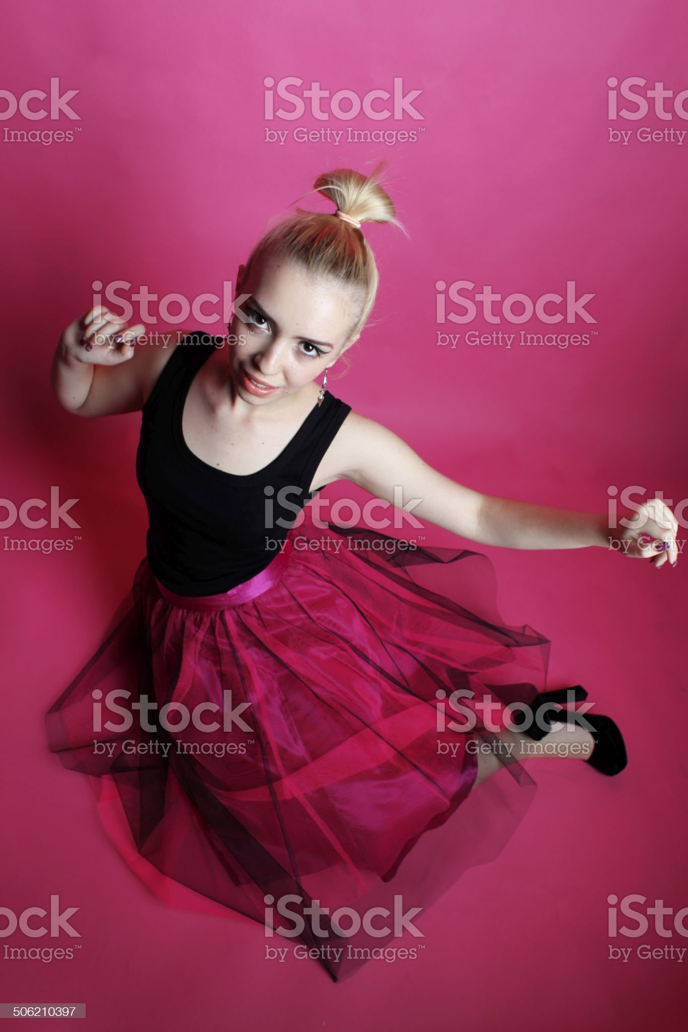 Young lady posing and dancing in the studio royalty-free stock photo