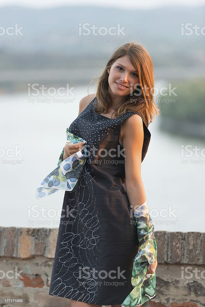 young lady posing outside royalty-free stock photo