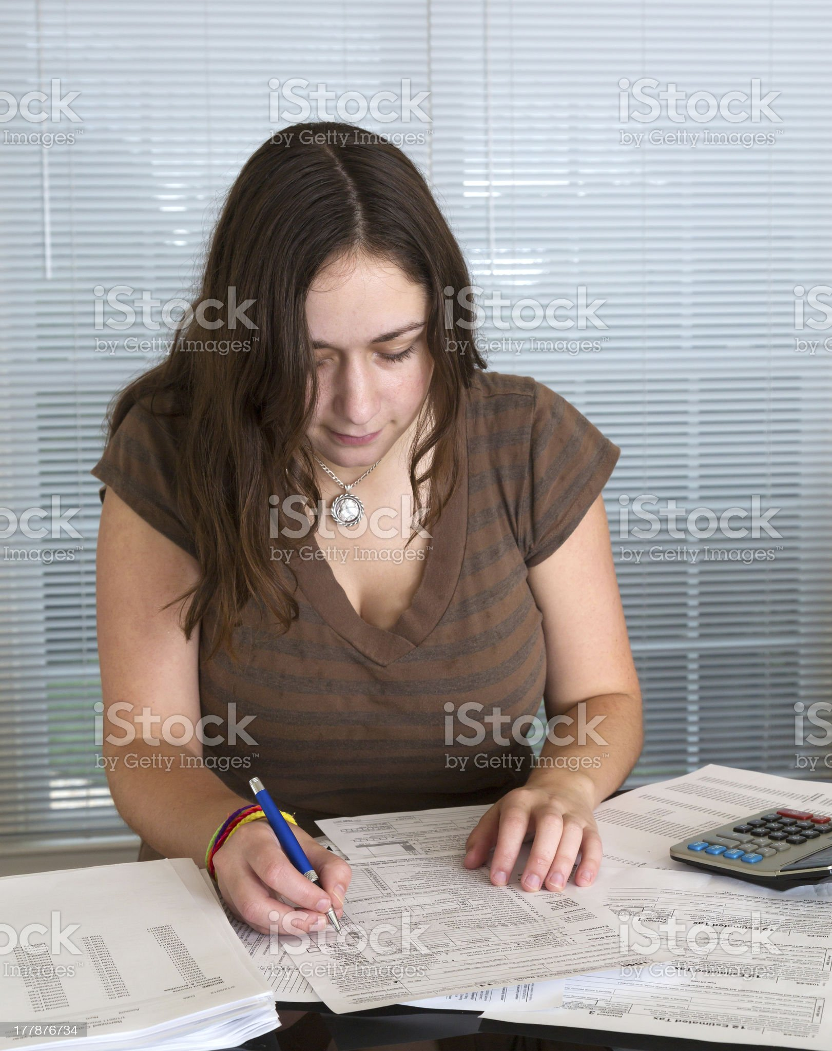 Young lady preparing USA tax form 1040 for 2012 royalty-free stock photo