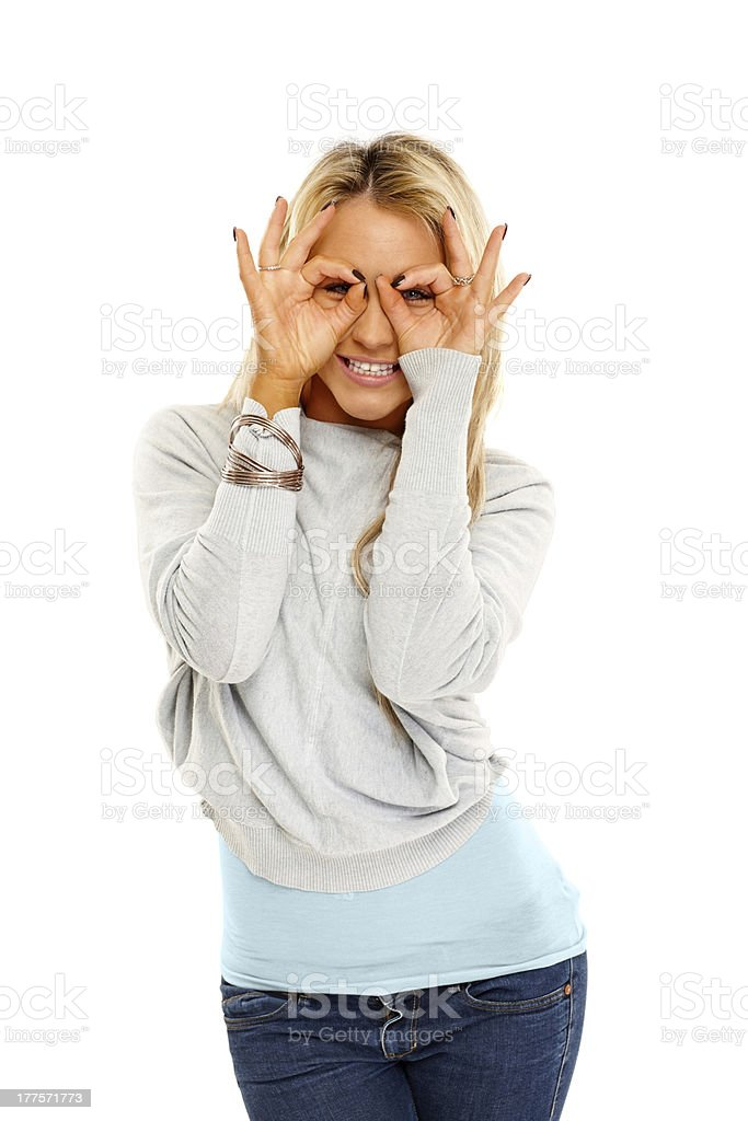 Young lady pretending to wear glasses royalty-free stock photo