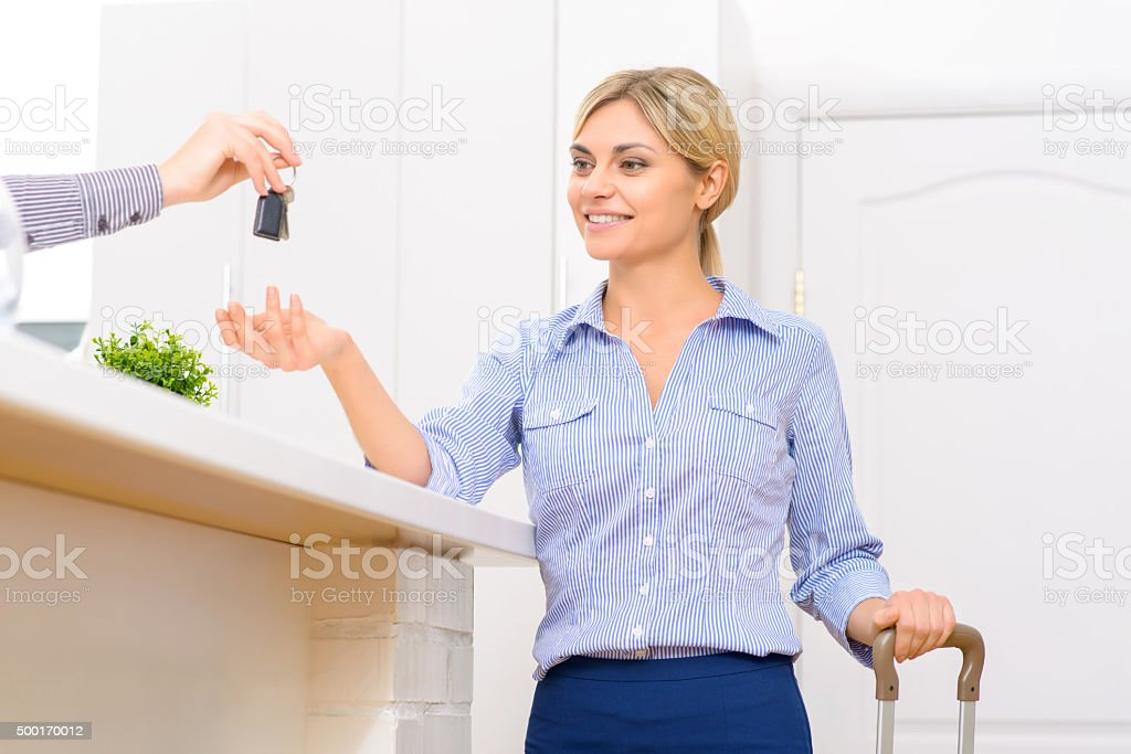Young lady receiving her room key stock photo