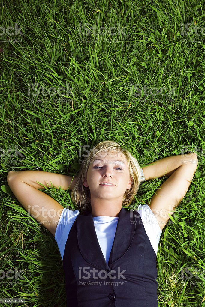 Young lady resting on the grass royalty-free stock photo