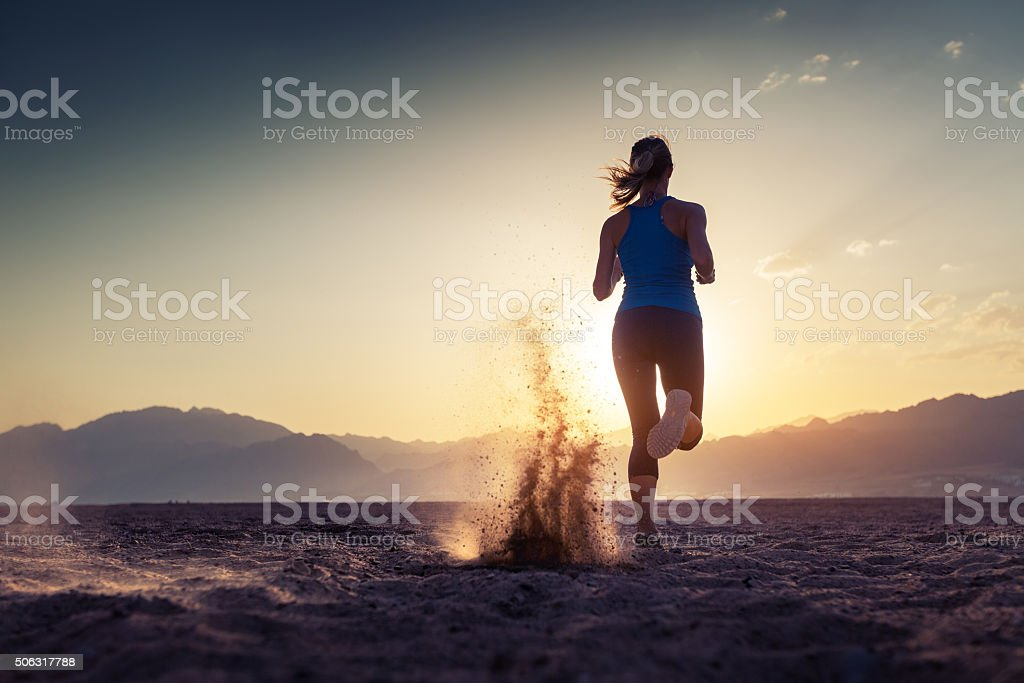 Young lady running stock photo