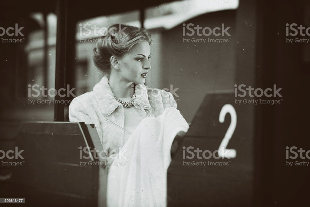Young lady sitting in a train wagon stock photo