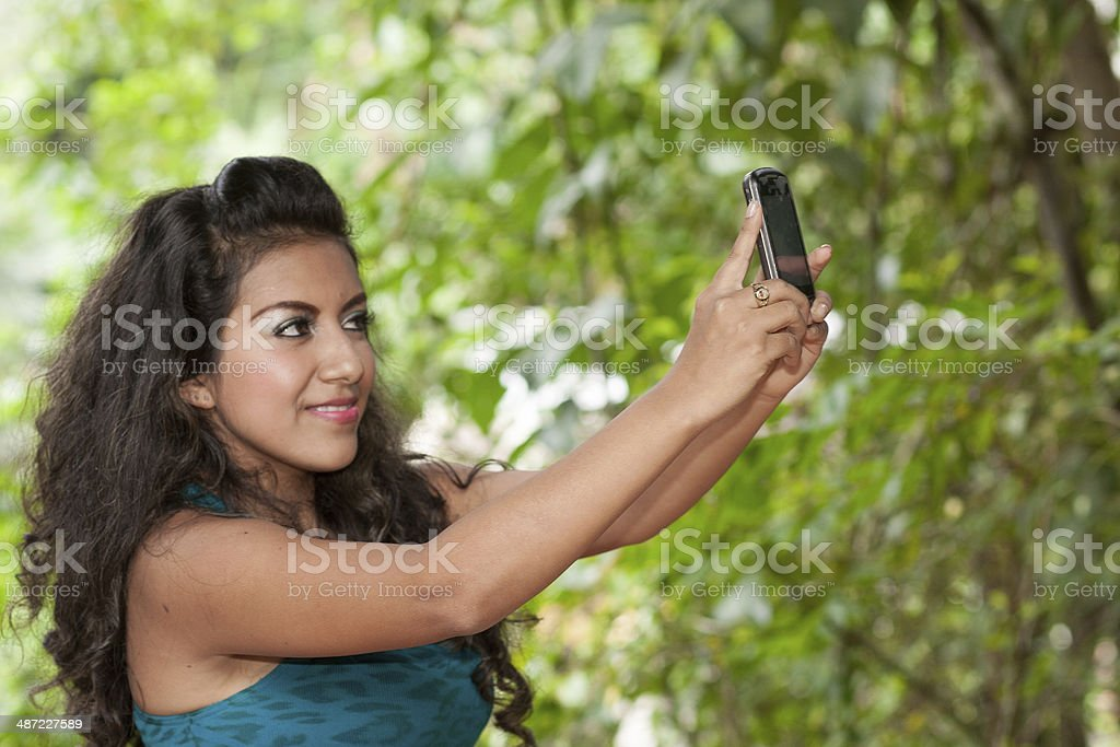 Young lady takeing selfie, self portrait stock photo