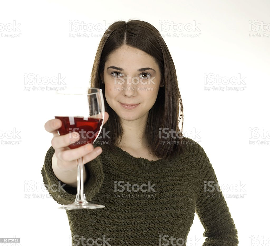 Young Lady Toasts with a Glass of Wine stock photo
