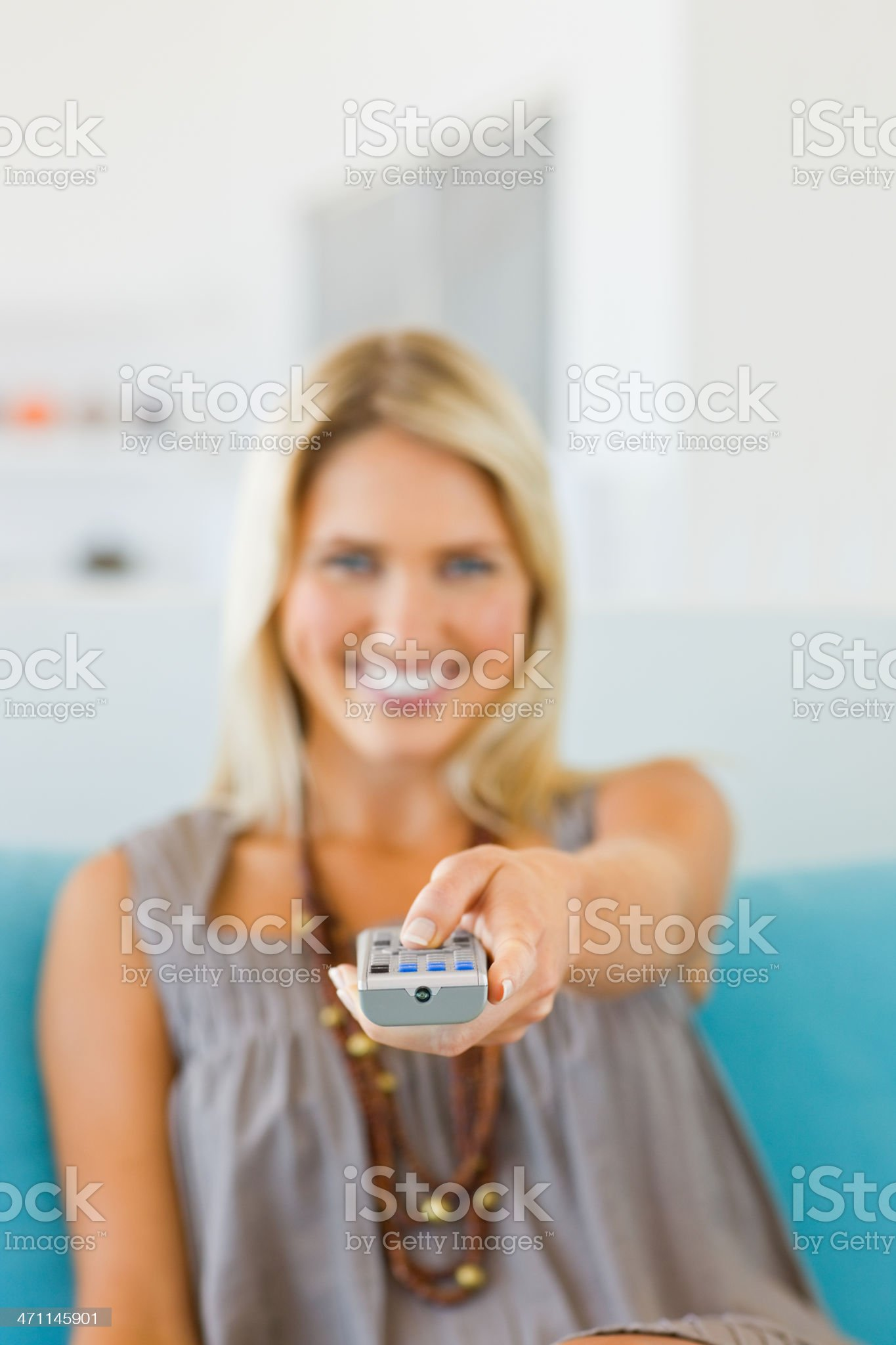 Young lady using remote control royalty-free stock photo