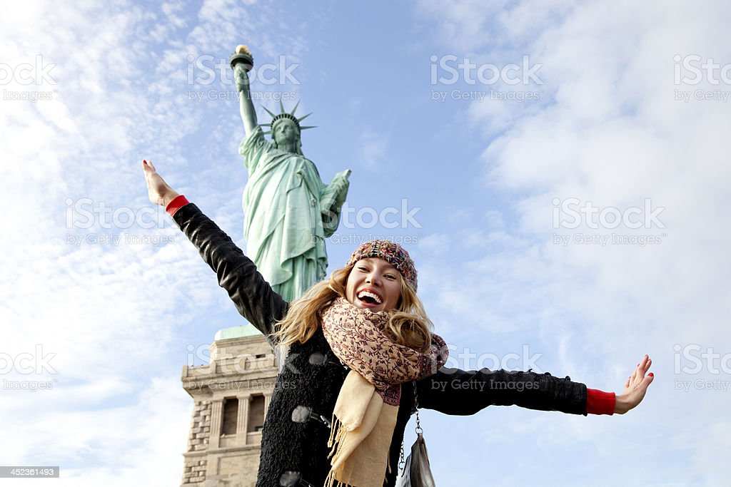 Young lady visiting Statue of Liberty in New York stock photo