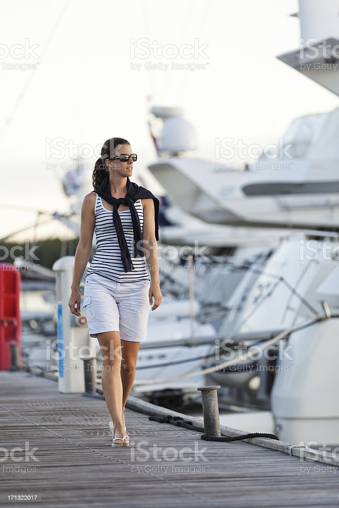 young lady walking in marina royalty-free stock photo