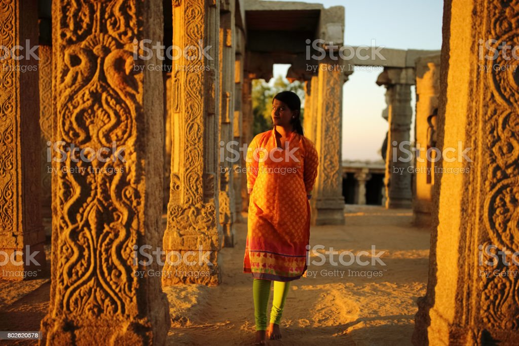 Young Lady Walks in the Lepakshi Temple stock photo