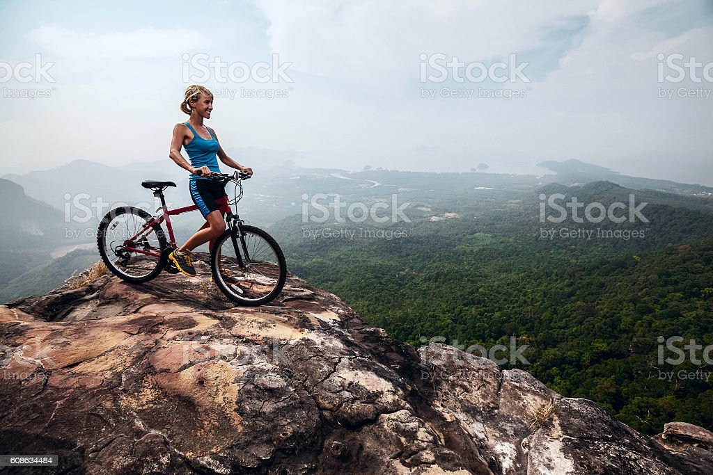Young lady with bicycle stock photo