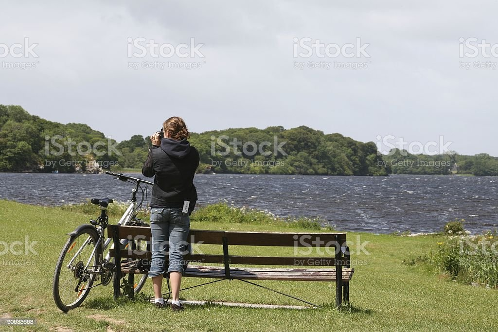 Young Lady With Bike and Camera stock photo