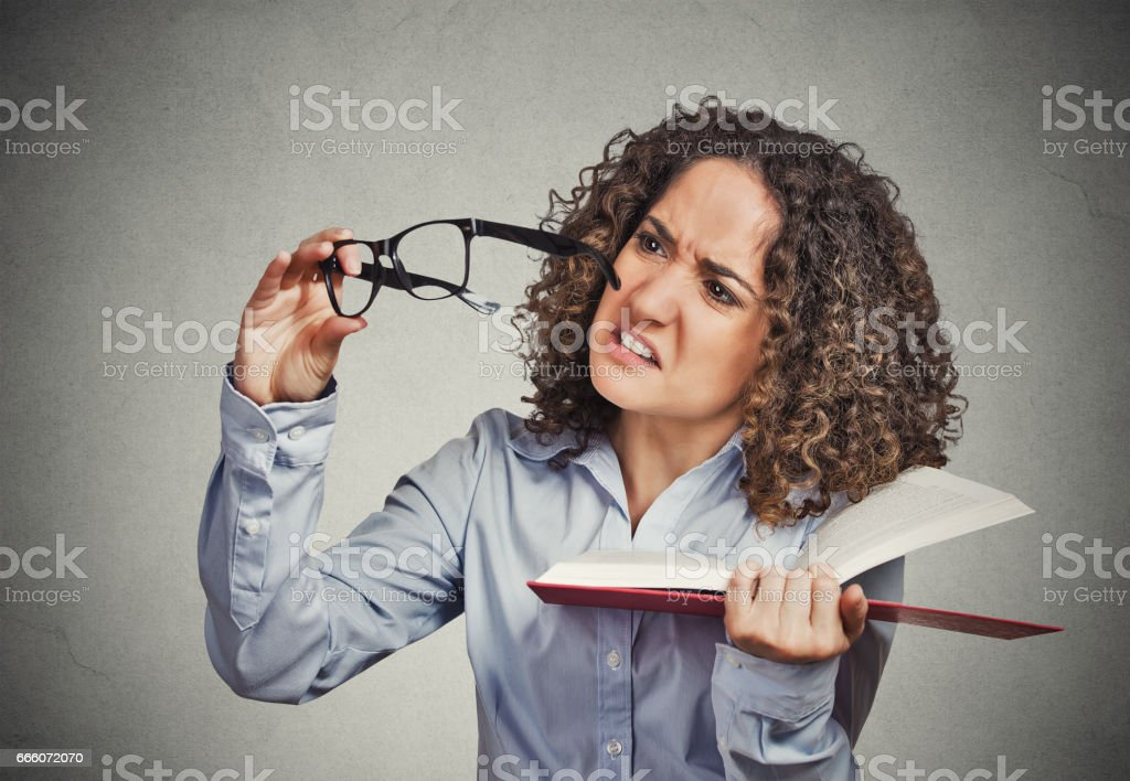 young lady, woman can't see read book has vision problems stock photo