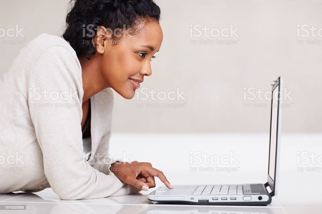 Young lady working on a laptop stock photo