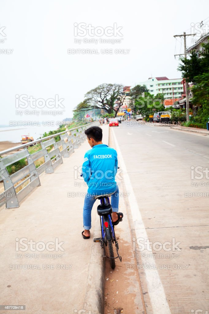 Young Laotian man with facebook branded jacket stock photo