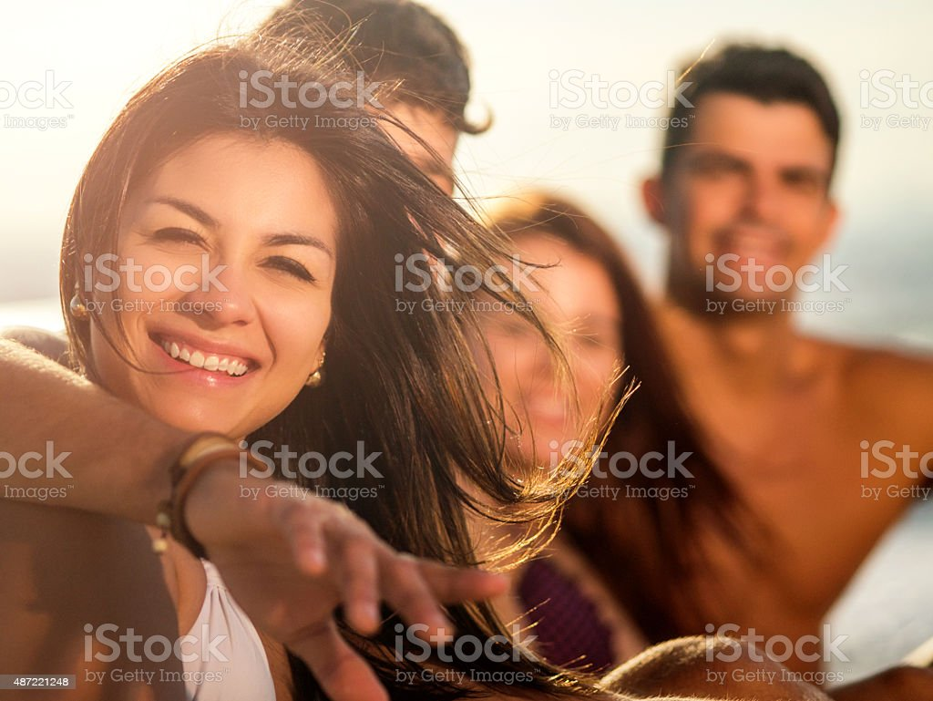Young Latin American friends enjoying in summer day. stock photo