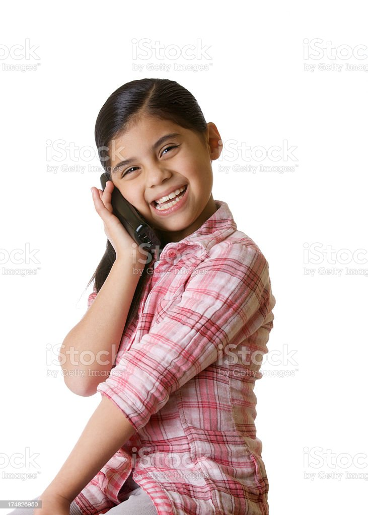 Young Latin american girl on the cell phone. royalty-free stock photo