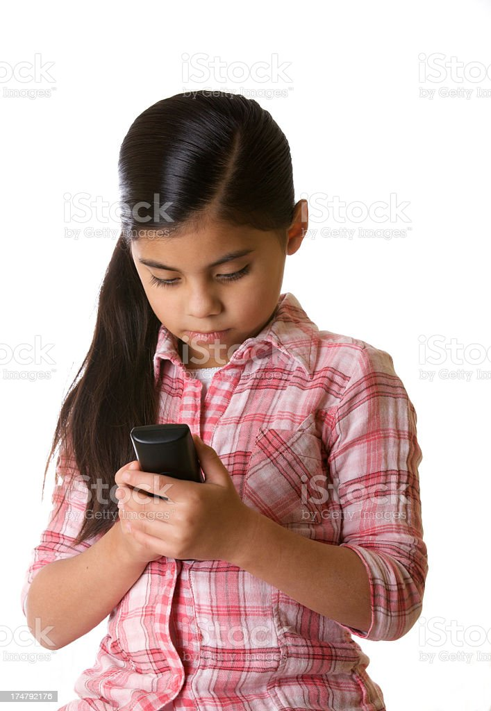 Young Latin american girl texting royalty-free stock photo