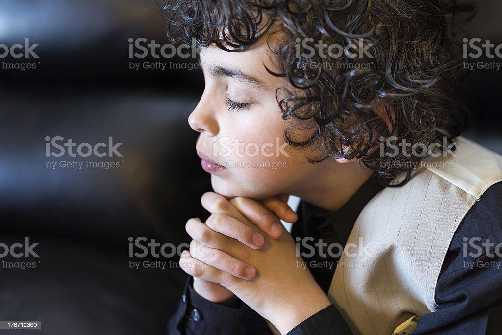 Young Latin Boy Praying royalty-free stock photo