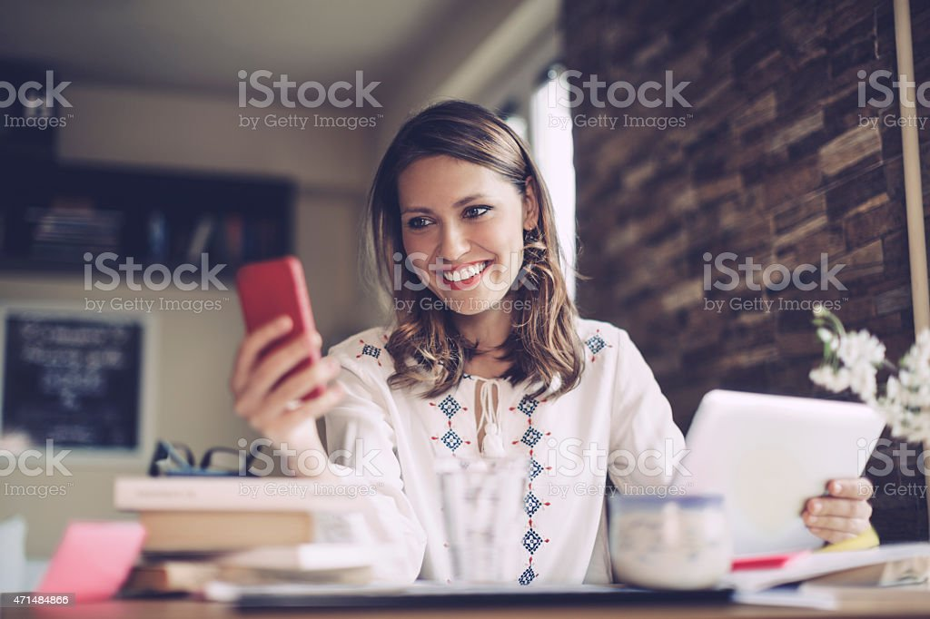 Young, latin businesswoman working at home stock photo