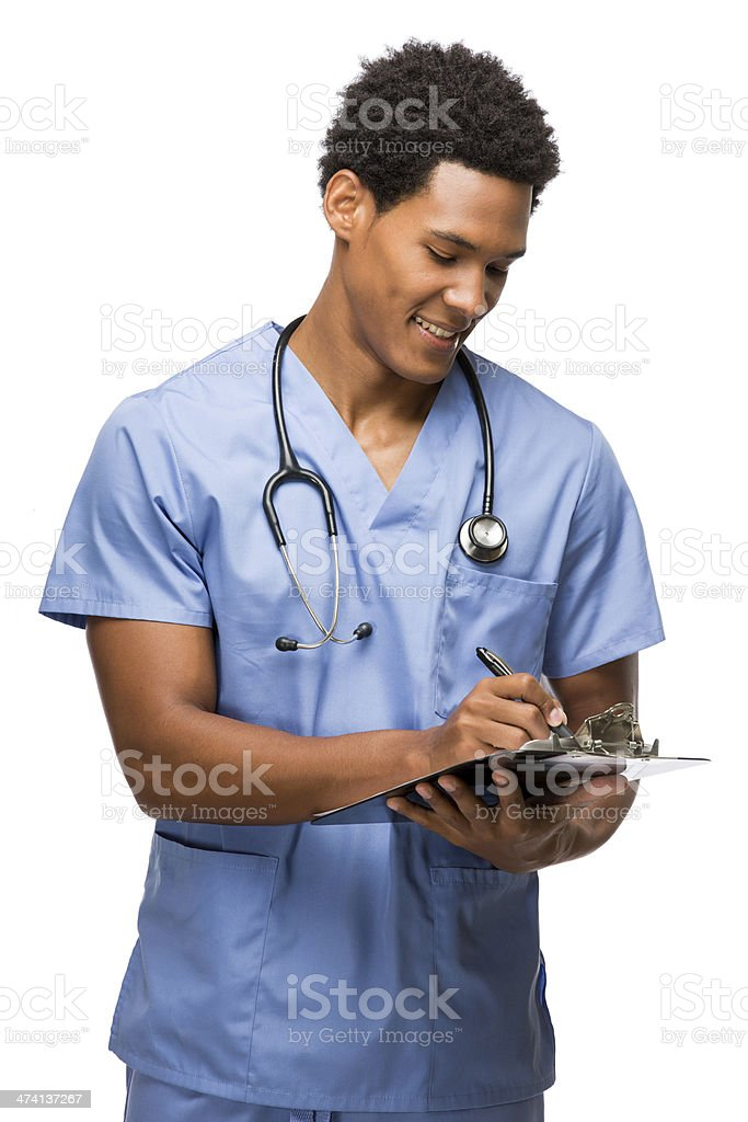 Young latin doctor writing on his clipboard stock photo