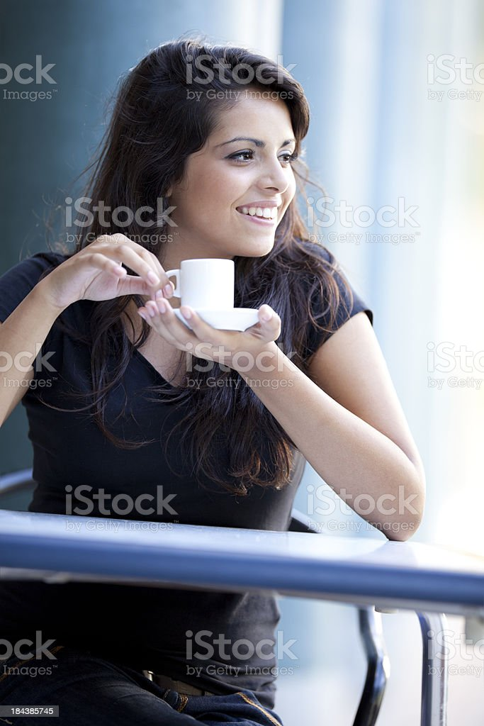 young latin woman drinking coffee royalty-free stock photo