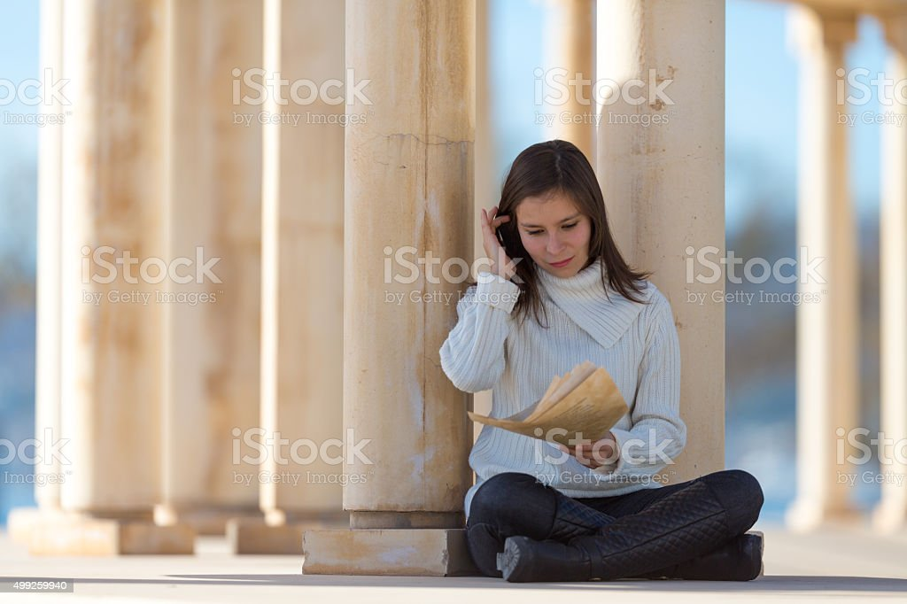 young latin woman reading love letter stock photo