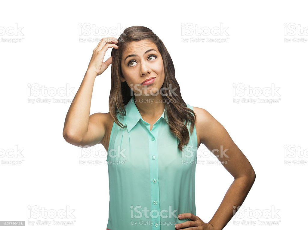 Young latin woman scratching head in thought stock photo