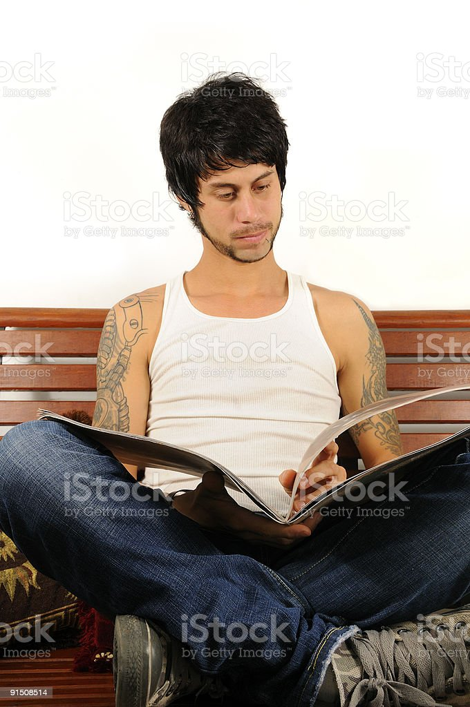 Young latino man reading royalty-free stock photo