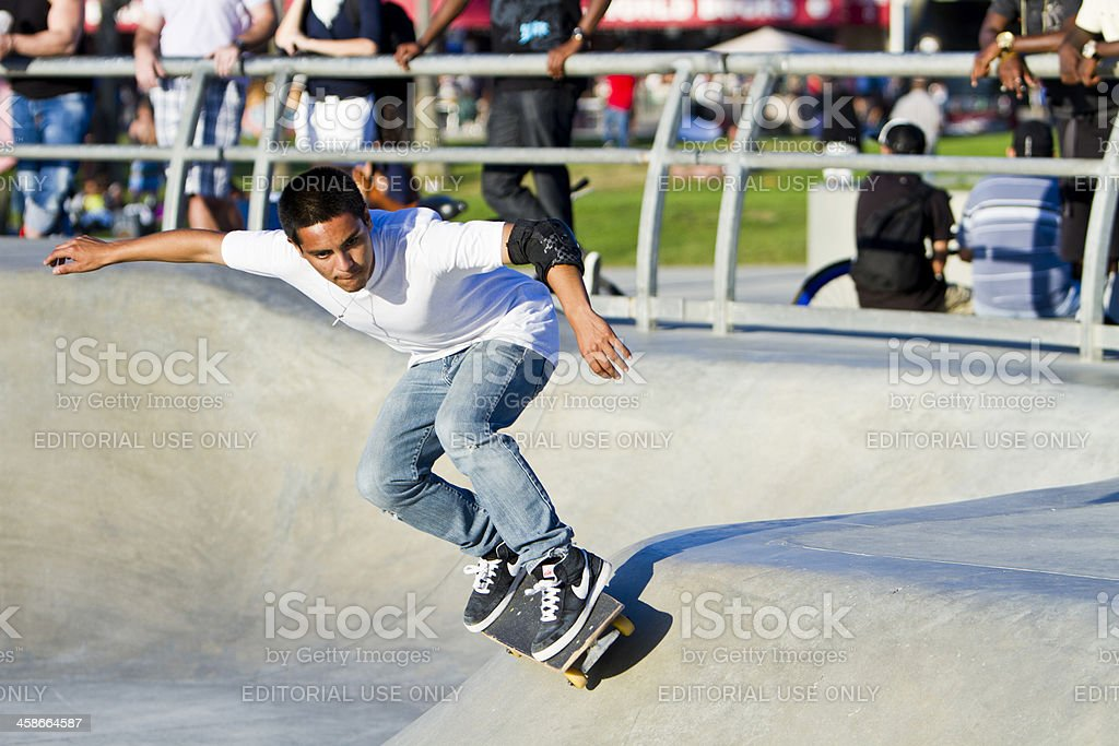 Young Latino Performing In Front Of Crowd At Skateboard Park royalty-free stock photo