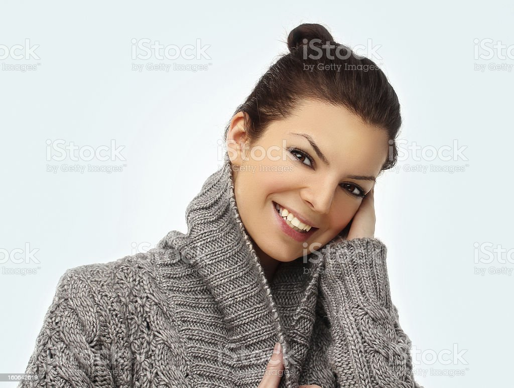 Young  laughing brunette woman  in warm sweater royalty-free stock photo