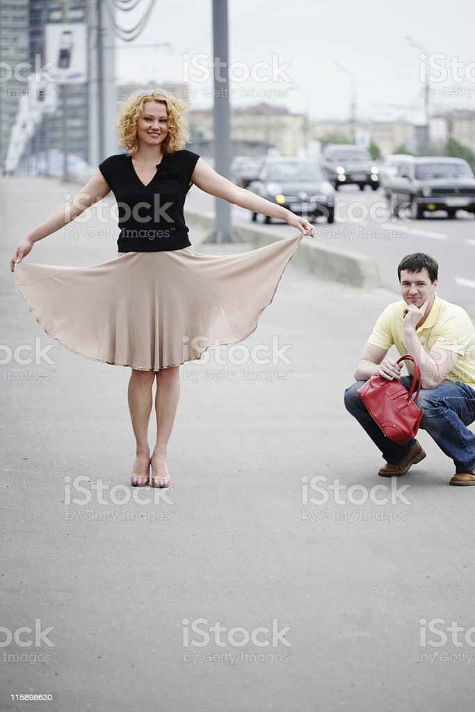 young laughing couple walking in city royalty-free stock photo